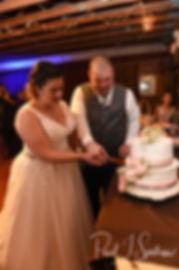 Adam & Ashley cut their wedding cake during their September 2018 wedding reception at Stepping Stone Ranch in West Greenwich, Rhode Island.