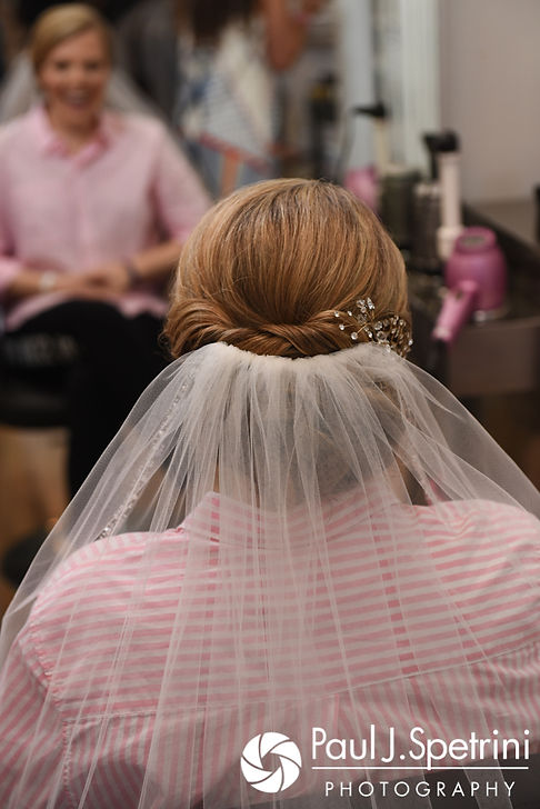 Melissa has her veil placed on during her May 2017 bridal hair and makeup appointment at New Leaf Hair Studio in Bristol, Rhode Island.