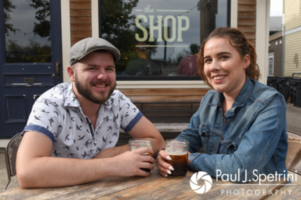 Alison and Gary smile for a photo at a coffee shop on Wickenden Street in Providence, Rhode Island during their September 2017 engagement session.