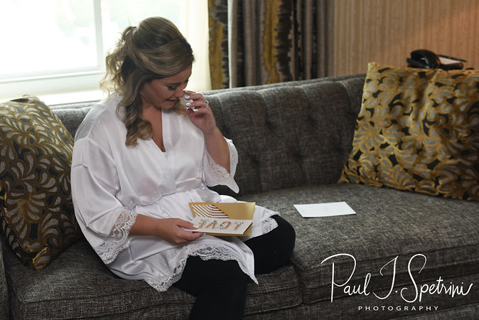 Sarah reacts to a letter from Anthony during her bridal prep session at The Omni Hotel in Providence, Rhode Island prior to her October 2018 wedding.