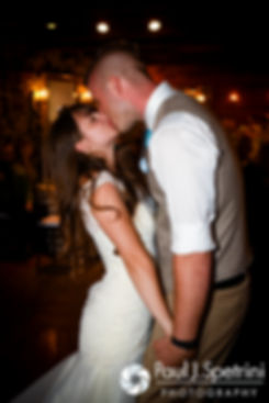 Krystal and Ian kiss during their May 2016 wedding reception at DeWolf Tavern in Bristol, Rhode Island.