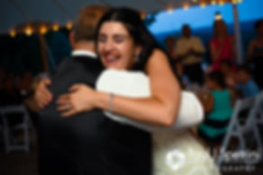 Lauryn hugs her father during her July 2016 wedding reception at the Overlook at Geer Tree Farm in Griswold, Connecticut.
