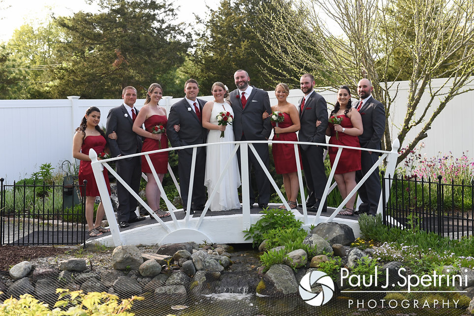 Latasha and Justin pose for a photo with their wedding party following their May 2016 wedding at Country Gardens in Rehoboth, Massachusetts.