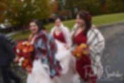Makayla's bridesmaids help her walk in her dress prior to her October 2018 wedding reception at Zukas Hilltop Barn in Spencer, Massachusetts.