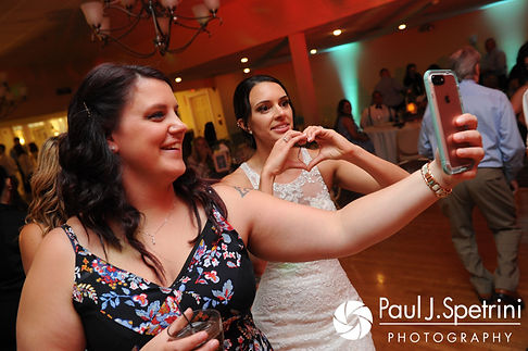 Cassie spends a moment with a friend via Facetime during her July 2017 wedding reception at Rachel's Lakeside in Dartmouth, Massachusetts.