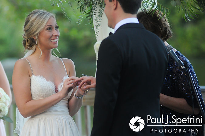 Laura puts Laki's ring on during her September 2017 wedding ceremony at Lake of Isles Golf Club in North Stonington, Connecticut.