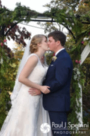 Mike and Rachel kiss during their October 2017 wedding ceremony at Castle Manor Inn in Gloucester, Massachusetts.