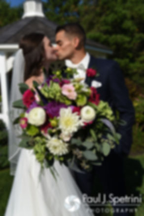 Alyssa and Alex kiss during a formal photo prior to their August 2016 wedding reception at LeBaron Hills Country Club in Lakeville, Massachusetts.