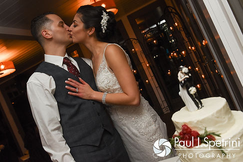 Gina and David kiss during their December 2016 wedding reception at the Waterman Grille in Providence, Rhode Island.