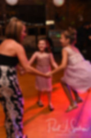 Guests dance during Adam & Ashley's September 2018 wedding reception at Stepping Stone Ranch in West Greenwich, Rhode Island.