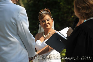 Jean Andrade listens to the officiant at her wedding.