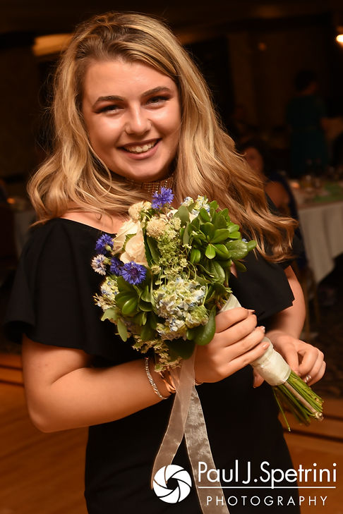 A guest shows off the bouquet she caught during Neil and Gianna's July 2017 wedding reception at Quidnessett Country Club in North Kingstown, Rhode Island.