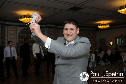 Shawn gets ready to toss the garter at his spring 2016 Rhode Island wedding at the Hotel Viking in Newport, Rhode Island.