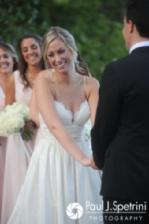 Laura smiles during her September 2017 wedding ceremony at Lake of Isles Golf Club in North Stonington, Connecticut.