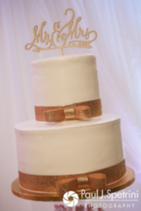 A look at Lucelene and Luis' wedding cake, on display during their June 2017 wedding reception at Al's Waterfront Restaurant in East Providence, Rhode Island.