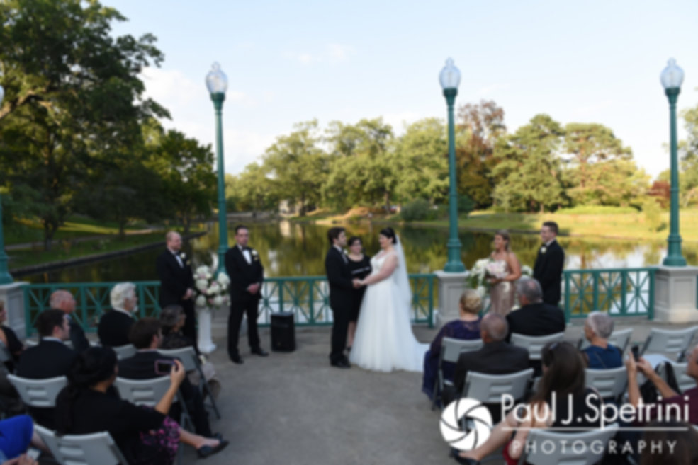 Allison and Len hold hands during their September 2017 wedding ceremony at the Roger Williams Park Casino in Providence, Rhode Island.