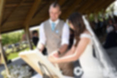 Krystal and Ian tie a Cord of Three Strands during their May 2016 wedding at Colt State Park in Bristol, Rhode Island.