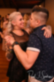 Guests dance during Zach & Kelly's June 2018 wedding reception at Blissful Meadows Golf Club in Uxbridge, Massachusetts.