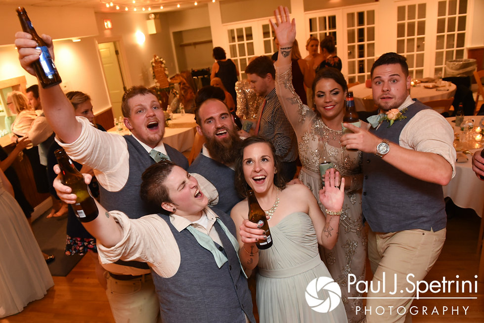 Arielle and Gary dance with guests during their September 2017 wedding reception at North Beach Club House in Narragansett, Rhode Island.