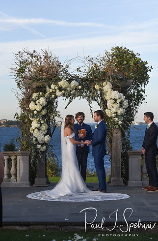 David and Whitney listen to their officant during their October 2018 wedding ceremony at Castle Hill Inn in Newport, Rhode Island.