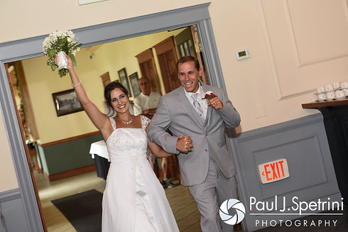 Heather and John enter the room during their July 2016 wedding reception at Crystal Lake Golf Club in Burrillville, Rhode Island.