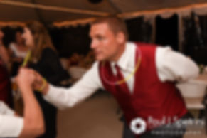 Guests dance under the tent at Latasha and Justin's May 2016 wedding at Country Gardens in Rehoboth, Massachusetts.