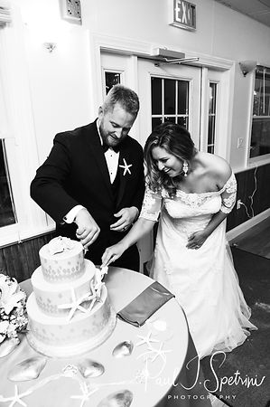 Cara & Brandon cut their wedding cake during their November 2018 wedding reception at the North Beach Clubhouse in Narragansett, Rhode Island.