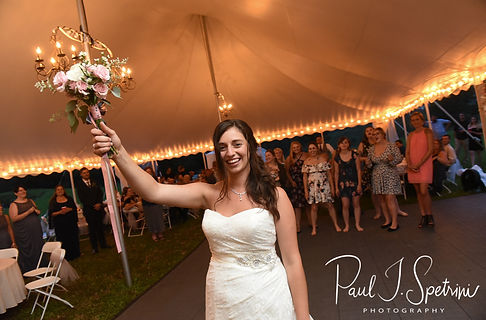 Karolyn tosses her bouquet during her August 2018 wedding reception at a private residence in Sterling, Connecticut.