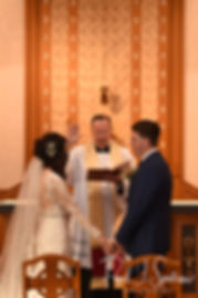 Stacey and Mack receive a marital blessing during their December 2018 wedding ceremony at St. Teresa's Church in Attleboro, Massachusetts.
