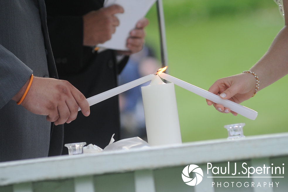 Melissa and Jordan light a unity candle during their May 2017 wedding ceremony at Independence Harbor in Assonet, Massachusetts.