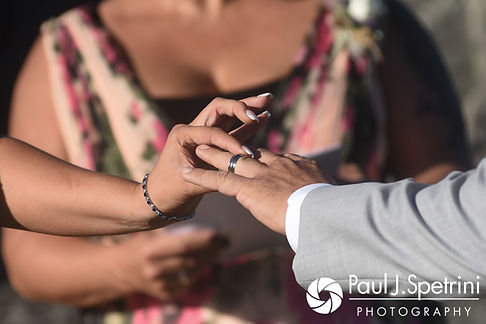 Jennifer places the ring on Kevin during her September 2017 wedding ceremony at Allen Hill Farm in Brooklyn, Connecticut.