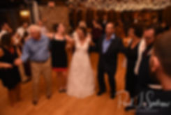 Rob and Allie dance with guests during their October 2018 wedding reception at The Towers in Narragansett, Rhode Island.