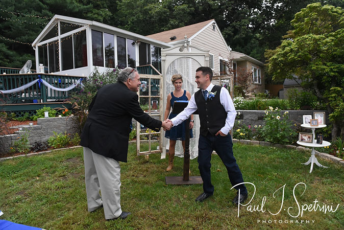 Josh shakes hands with a guest prior to his September 2018 wedding ceremony at their home in Coventry, Rhode Island.