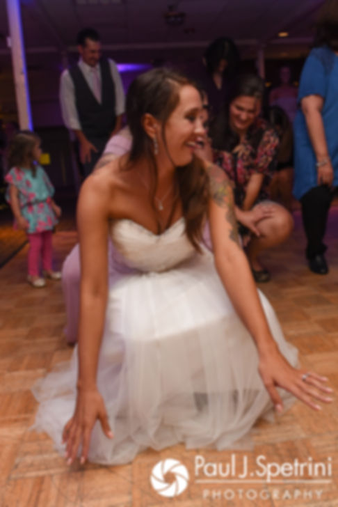 Stacey dances during her September 2017 wedding reception in Warren, Rhode Island.