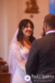 Samantha looks at Dale during her October 2017 wedding ceremony at St. Robert's Church in Johnston, Rhode Island.