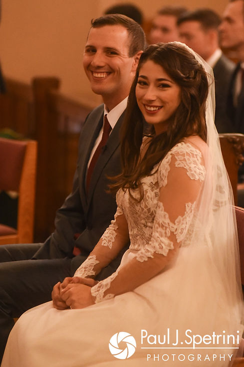 Keiran and Jessica smile during their October 2017 wedding ceremony at the Assumption of the Blessed Virgin Mary Church in Providence, Rhode Island.