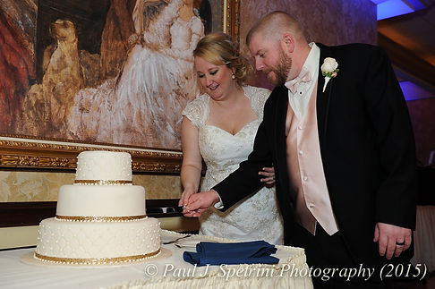 Kerry and Adam cut the cake at their fall wedding at Quidnessett Country Club in North Kingstown, Rhode Island on October 23rd, 2015.