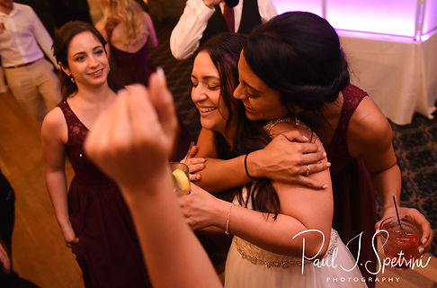 Lizzy gets a hug during her September 2018 wedding reception at Crystal Lake Golf Club in Mapleville, Rhode Island.