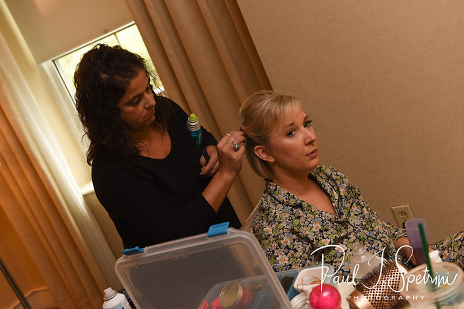 Meghan has her hair fixed at the Biltmore in Providence, Rhode Island prior to her September 2018 wedding ceremony at Immaculate Conception Church in Cranston, Rhode Island.