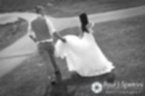 Ian helps Krystal walk in her dress following their May 2016 wedding at Colt State Park in Bristol, Rhode Island.