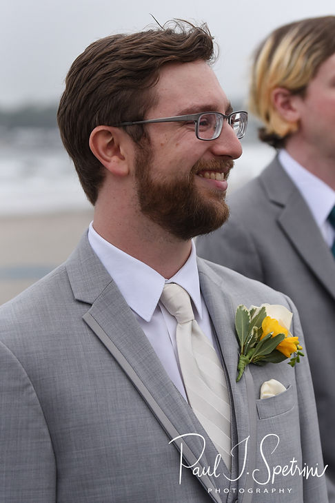 Justin smiles as Amber walks down the aisle during his June 2018 wedding ceremony at North Beach Clubhouse in Narragansett, Rhode Island.