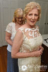 Debbie has her dress zipped up prior to her June 2016 wedding in Barrington, Rhode Island.