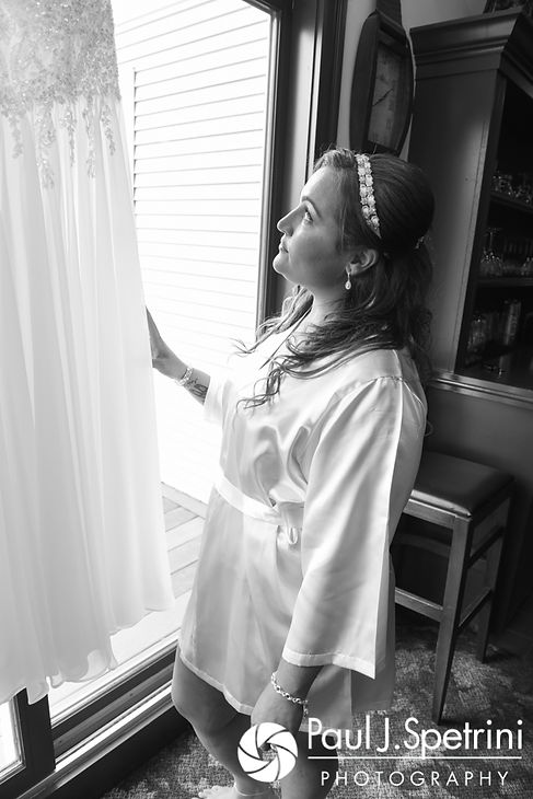 Toni looks at her wedding dress prior to her August 2017 wedding ceremony at Crystal Lake Golf Club in Mapleville, Rhode Island.