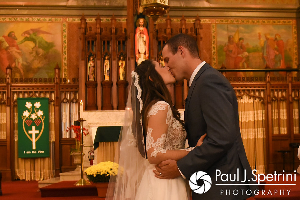 Keiran and Jessica kiss during their October 2017 wedding ceremony at the Assumption of the Blessed Virgin Mary Church in Providence, Rhode Island.