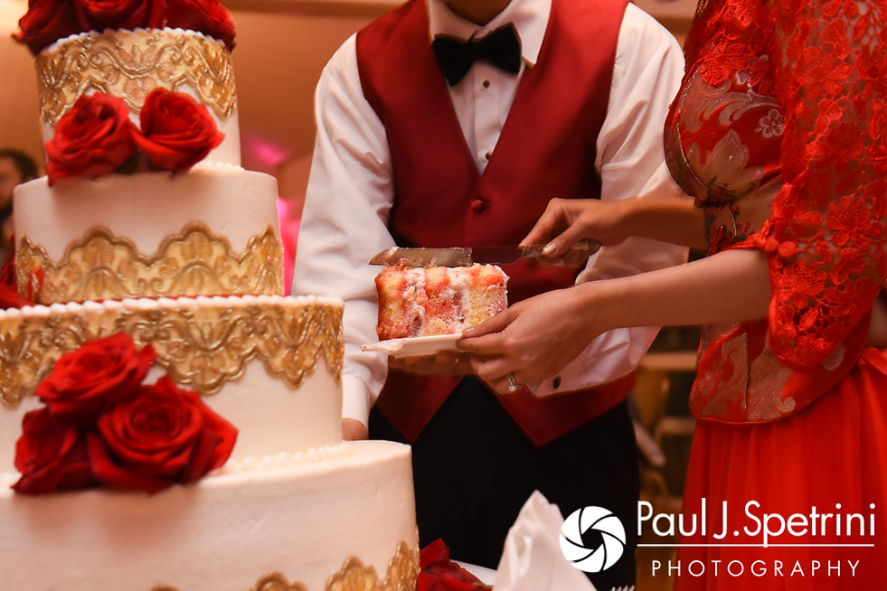 Cynthia and Ao cut their wedding cake during their August 2017 wedding reception at Lake Pearl in Wrentham, Massachusetts.