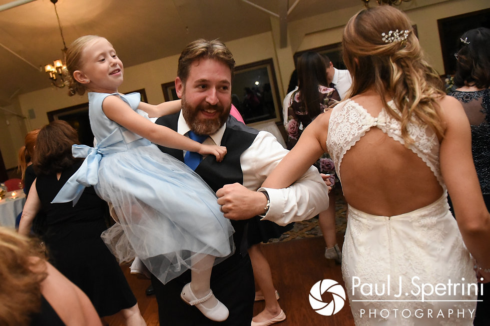 Kevin and Joanna dance with a flower girl during their October 2017 wedding reception at Cranston Country Club in Cranston, Rhode Island.
