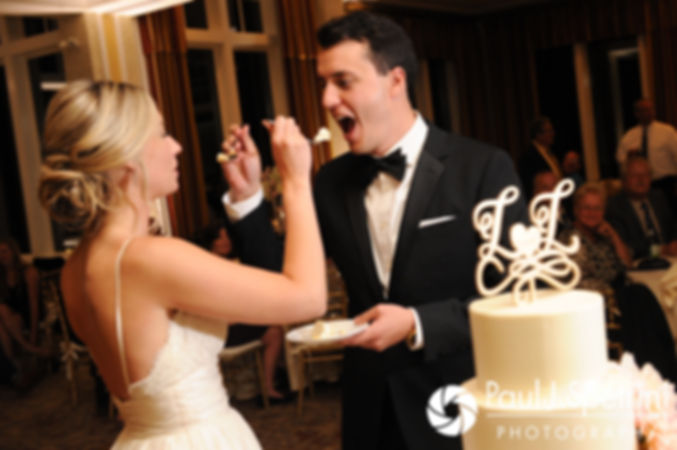 Laura and Laki cut their wedding cake during their September 2017 wedding reception at Lake of Isles Golf Club in North Stonington, Connecticut.