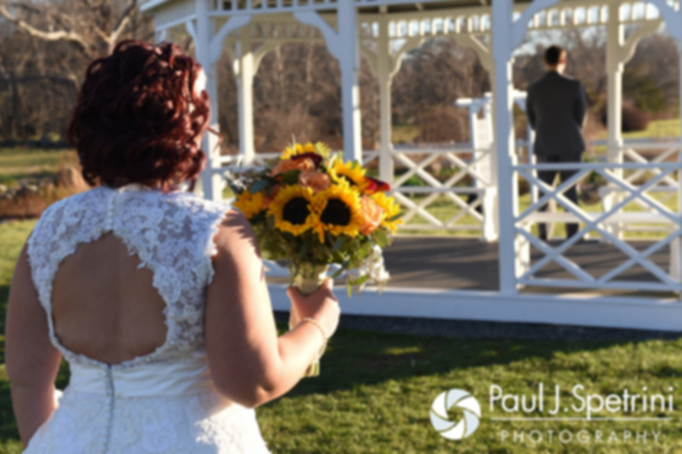 Crystal walks toward Andy as part of their first look prior to their November 2016 wedding ceremony at the Salem Cross Inn in West Brookfield, Massachusetts.