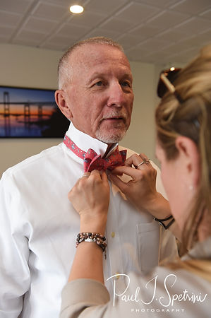 Mike has his tie adjusted prior to his May 2018 wedding ceremony aboard the Schooner Aurora boat in the waters off Newport, Rhode Island.