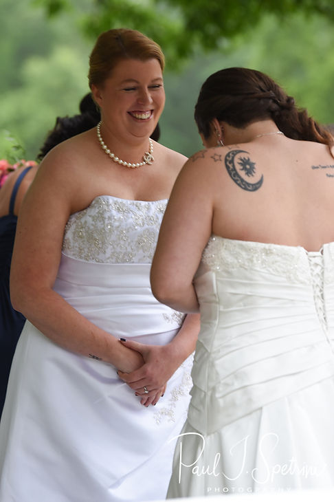Marijke smiles at Laura during her June 2018 wedding ceremony at Independence Harbor in Assonet, Massachusetts.